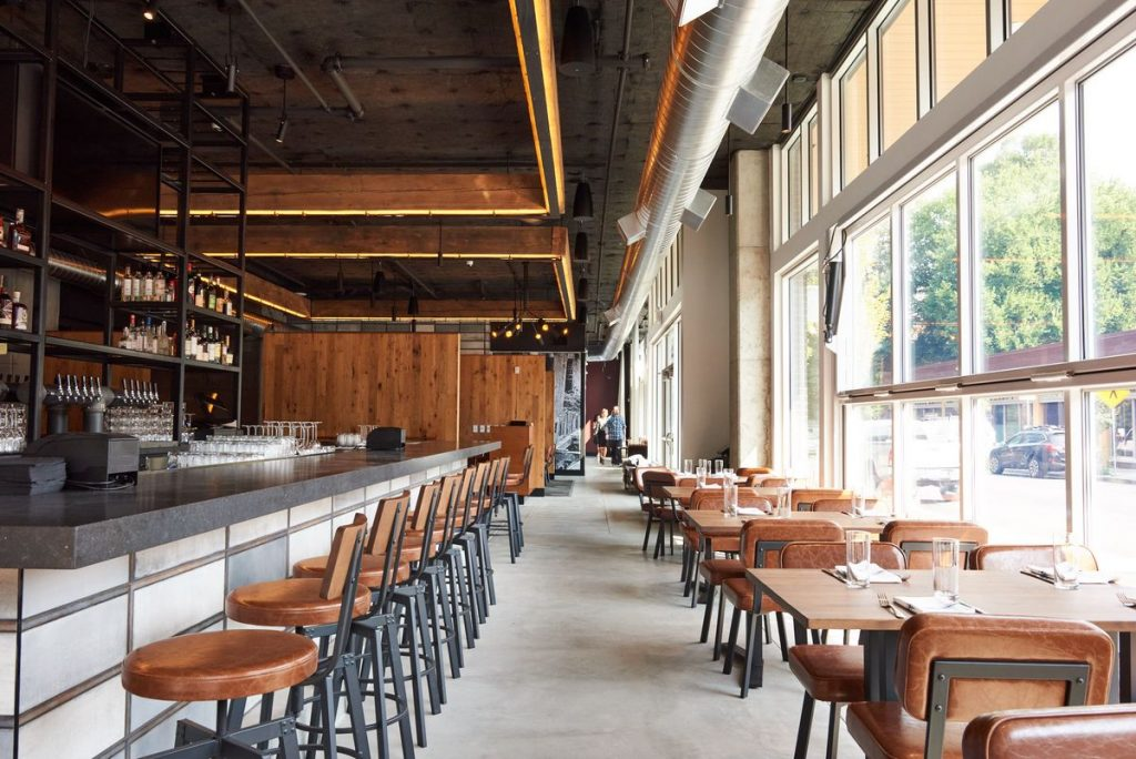 Floor-to-ceiling roll-up doors let in lots of light Dina Avila/EPDX | Tanner Creek Tavern